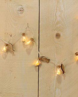 Giranden mit kleinen Muschelgläsern leuchtend